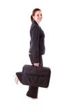 Young business woman with suitcase Stock Photography