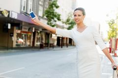 Business woman pulling suitcase bag walking in city Royalty Free Stock Photography