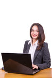 Young business woman at a table with a laptop Stock Image