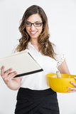 Young business woman with a tablet and a bowl in her hand Stock Images
