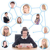 Young business woman with tablet pc and her friends or clients  Royalty Free Stock Photos