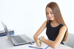 Young business woman taking notes Royalty Free Stock Image