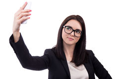 Young business woman taking selfie photo with smart phone isolat Stock Image