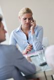 Young business woman talk by cellphone on meetng Stock Image