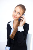 Young business woman talking on the cell phone. Portrait of cute young business woman talking on the cell phone Royalty Free Stock Image