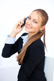 Young business woman talking on the cell phone. Portrait of cute young business woman talking on the cell phone Stock Photography
