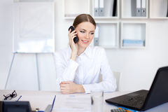 Young business woman talking on cell phone Stock Photo