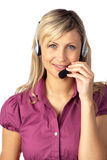 Young business woman talking on a headset Royalty Free Stock Images