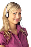 Young business woman talking on a headset Stock Images