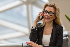 Young business woman talking on mobile phone Stock Photos