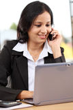 Young business woman talking on mobile phone Royalty Free Stock Photo
