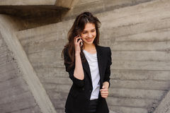 Young business woman talking on mobile phone Stock Photo