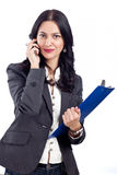 Young business woman talking on a phone Stock Photo