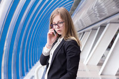 Young business woman talking on the phone in the business center Stock Photography
