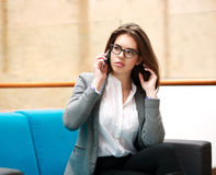 Young business woman talking on phone indoors Stock Image