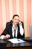Young business woman talking by phone in office Stock Photography