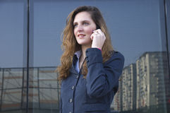 Young business woman talking stock image