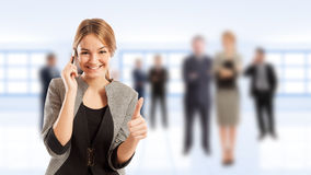 Young business woman talking on smartphone Royalty Free Stock Photography