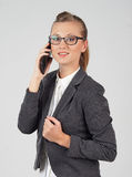 Young business woman with the telephone Stock Photos