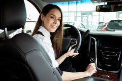Young business woman test drive her new car. stock photography