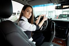 Young business woman test drive her new car. stock photos