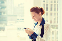 Young business woman texting on her smart phone Royalty Free Stock Images