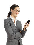 Young  business woman texting on phone. Young confident business woman texting on phone Royalty Free Stock Images