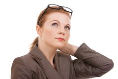 Young business woman thinking. Beautiful young business woman thinking about something Royalty Free Stock Images
