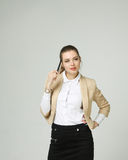 Young business woman thinking, holding pen in hand Royalty Free Stock Photography