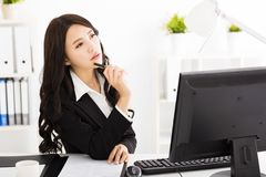 Young business woman thinking Royalty Free Stock Photo