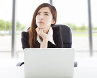 Young business woman thinking in the office Royalty Free Stock Image