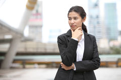 Young business woman thinking something Stock Photography