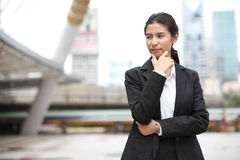Young business woman thinking something Stock Image