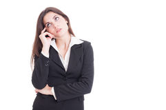 Young business woman thinking and wondering Royalty Free Stock Photo