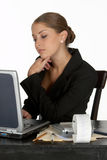 Young Business Woman in Thought at Computer Royalty Free Stock Photography