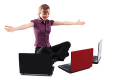 Young business woman with three laptops Stock Photography