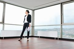 Young business woman throw papers in air. Young business woman throw papers and documents from joy in air representing concept of freedom joy and stress control royalty free stock images