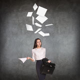 Young business woman throws up paper sheets. Stock Image