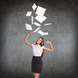 Young business woman throws up paper sheets. Royalty Free Stock Photography