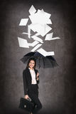 Young business woman throws up paper sheets. Royalty Free Stock Photo