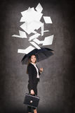 Young business woman throws up paper sheets. Stock Photos