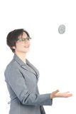 Young business woman tossing quarter dollar Stock Photo