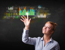 Young business woman touching colorful charts and diagrams Stock Images