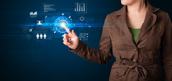 Young business woman touching future web technology buttons and. Business woman touching future web technology buttons and icons Royalty Free Stock Images