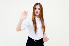 Young business woman touching virtual screen on white Stock Photo