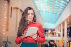 Young business woman is in trademark center and is  presenting something on tablet computer Stock Photography