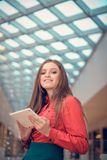 Young business woman is in trademark center and is  presenting something on tablet computer Stock Images