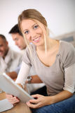 Young business woman at training with tablet Royalty Free Stock Photo