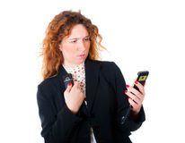 Young business woman with two mobile phones. Isolated over white background Royalty Free Stock Images