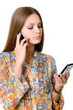Young business woman with two mobile phones Stock Photos